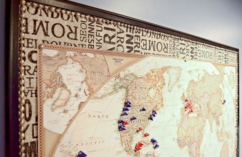 DIY push pin travel map with fabric backing and red and blue flag pins