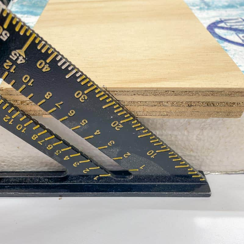 marking angle of French cleat cut on end of board with a speed square
