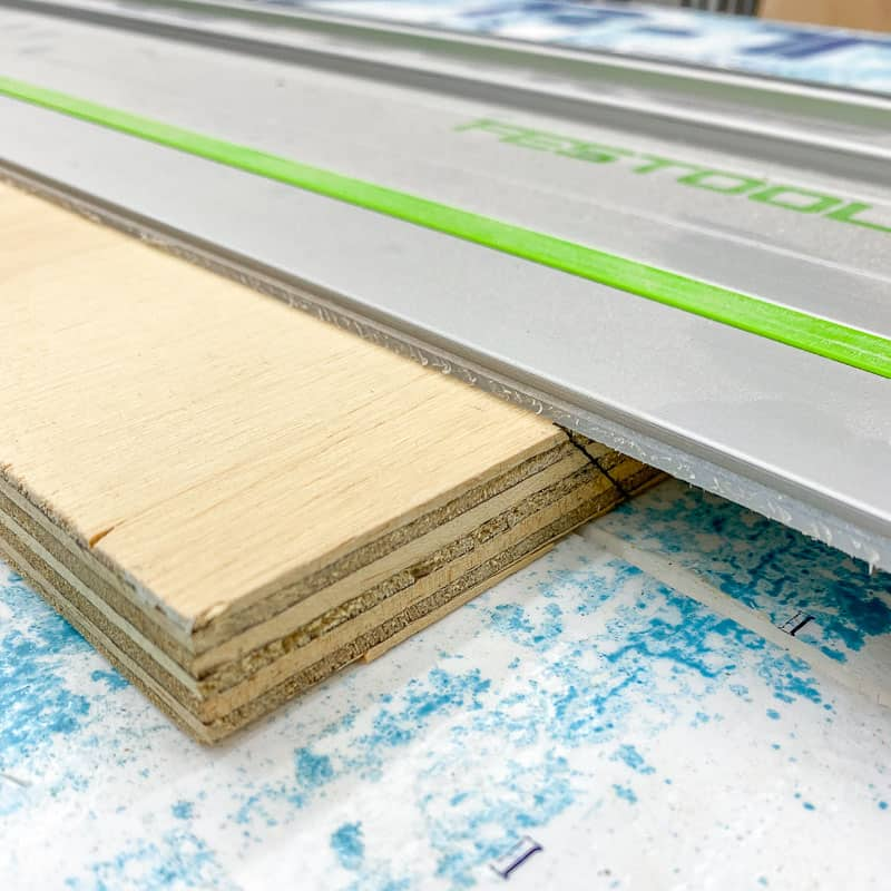 lining up track saw edge with mark for French cleat
