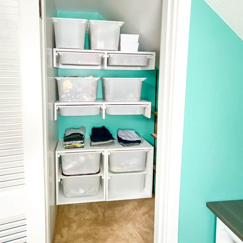 DIY custom closet with storage bins and shelves