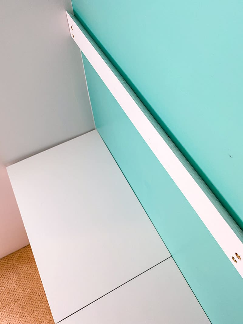 French cleat on wall above wall mounted storage bins