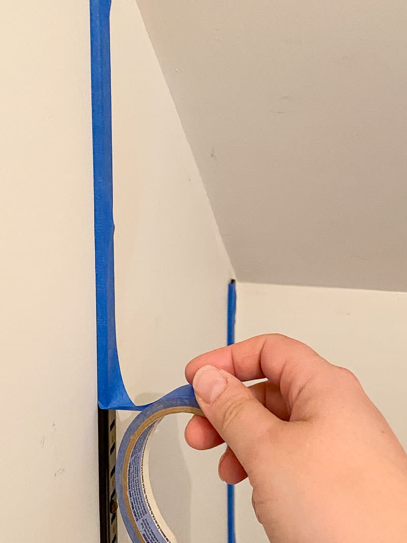 covering vertical brackets of shelving system with painter's tape