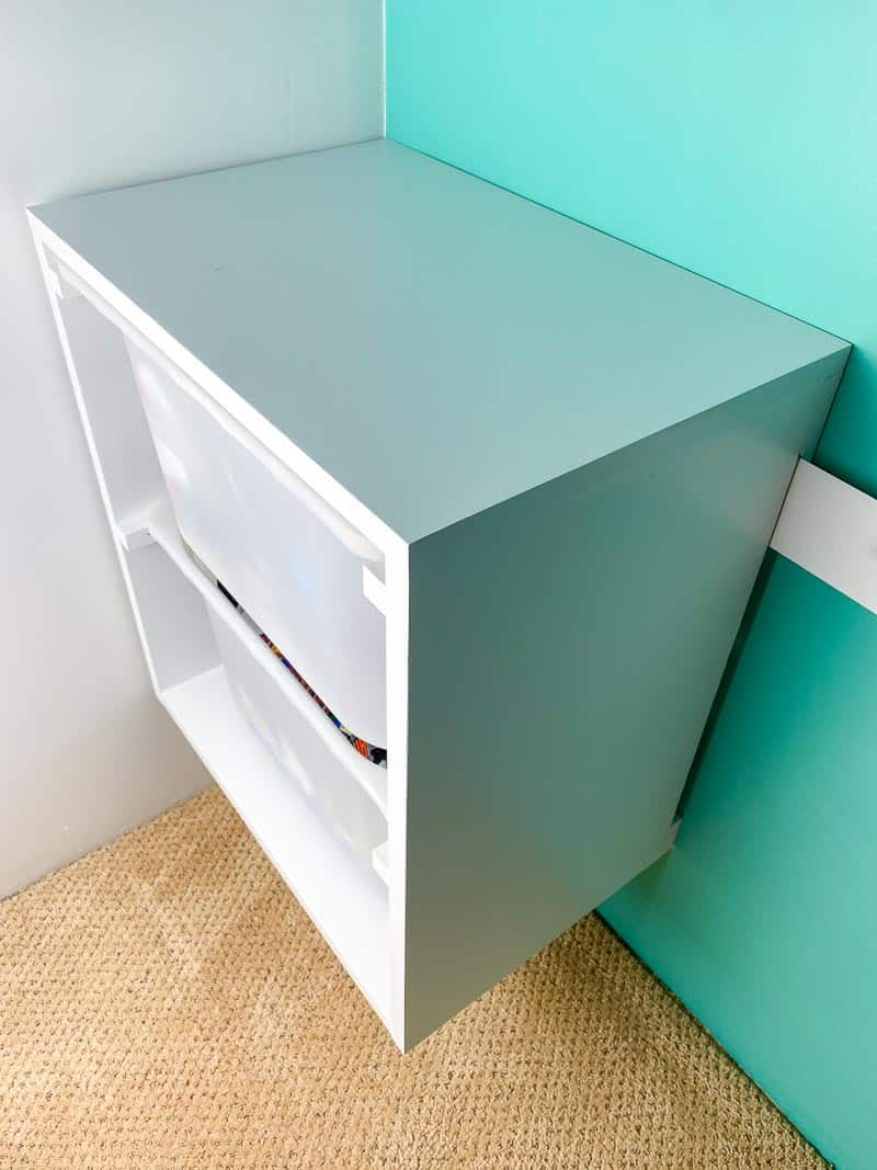 wall mount storage bins on French cleat in closet
