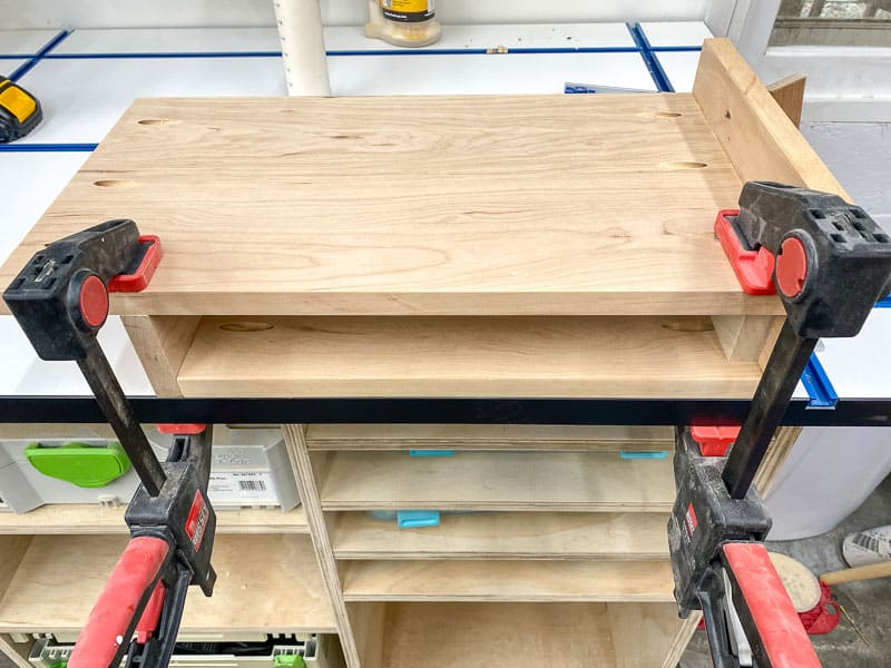 attaching shelf to the underside of the laptop stand