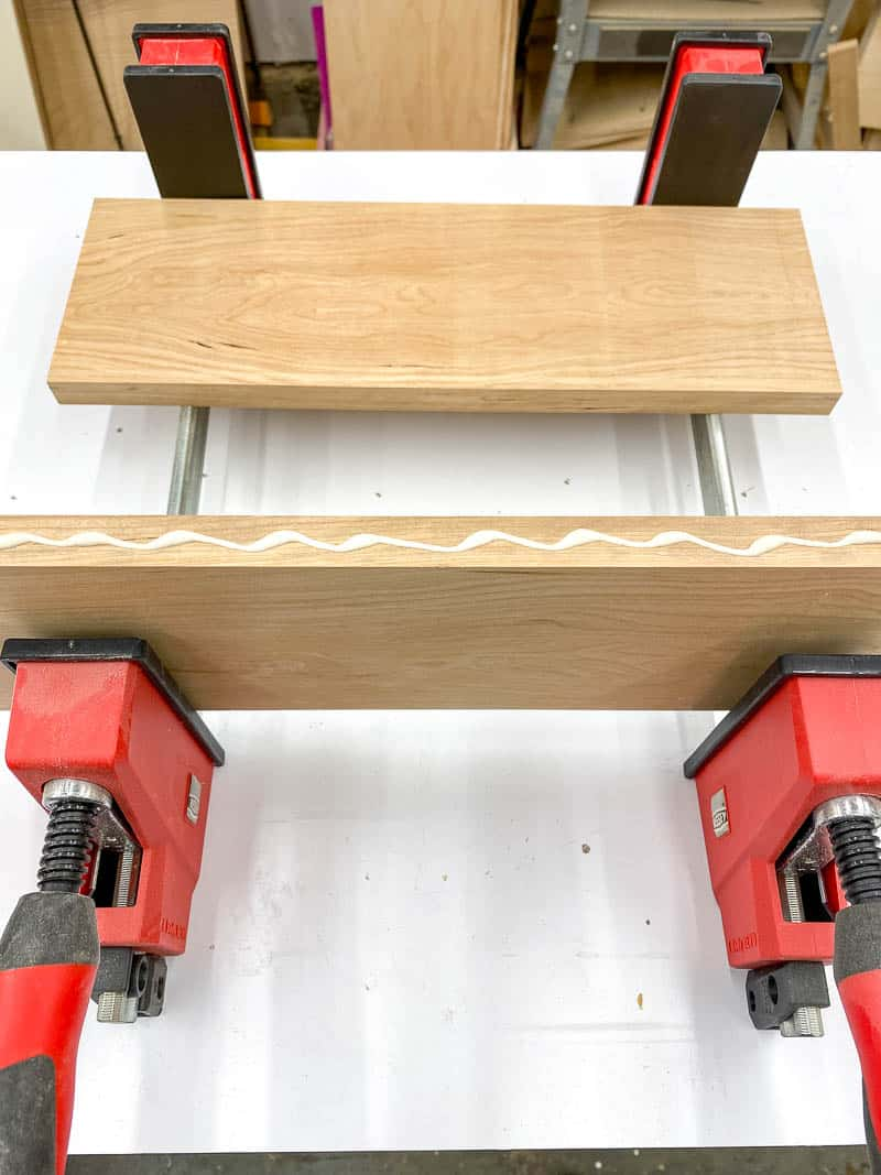 wood glue applied to the edge of one board before clamping