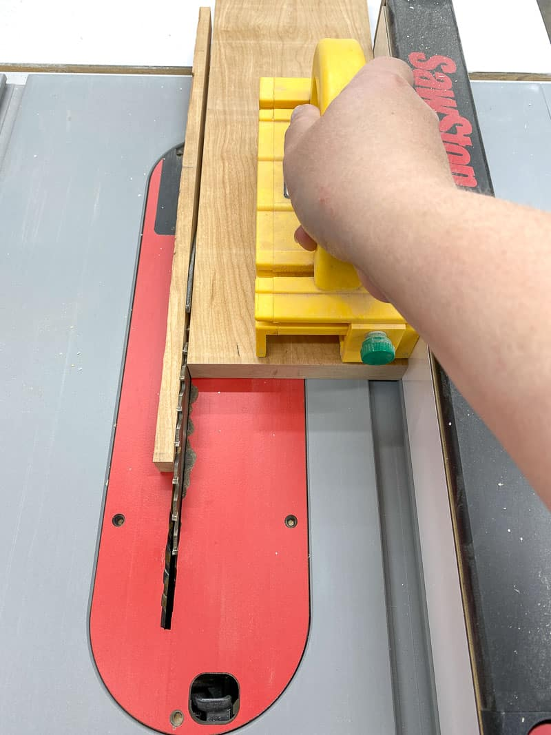 cutting off rough edge of board at the table saw