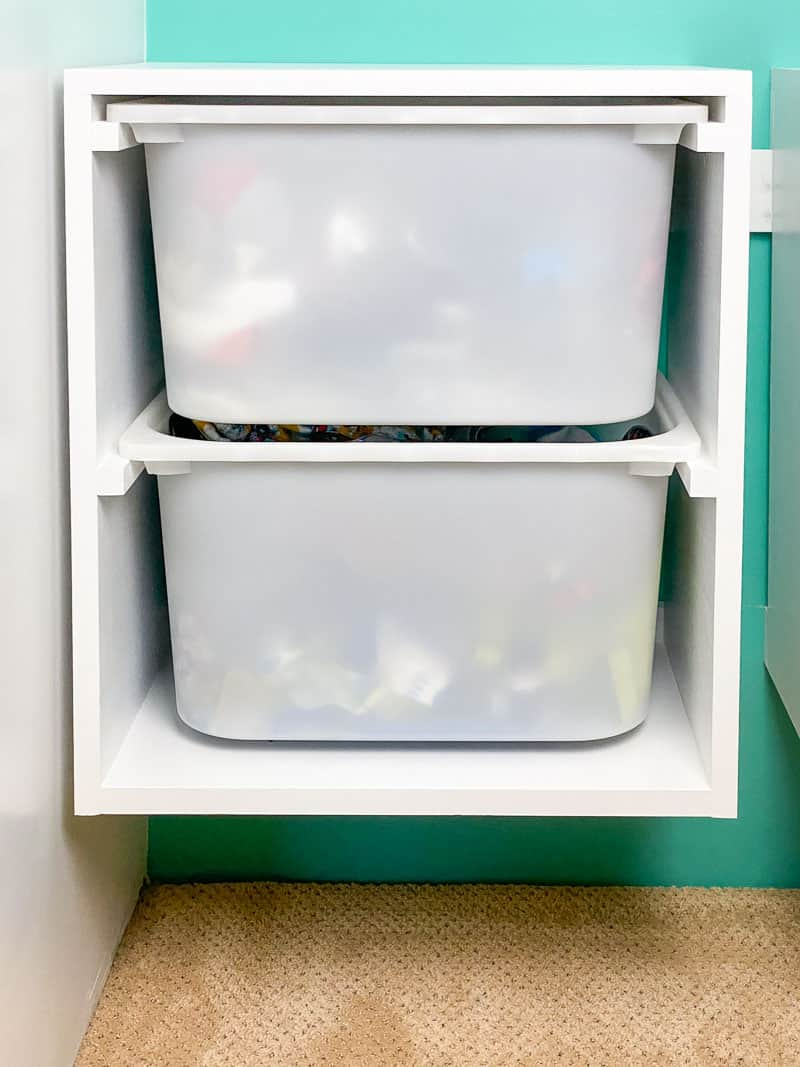 DIY wall mount storage bins hanging from French cleat in closet