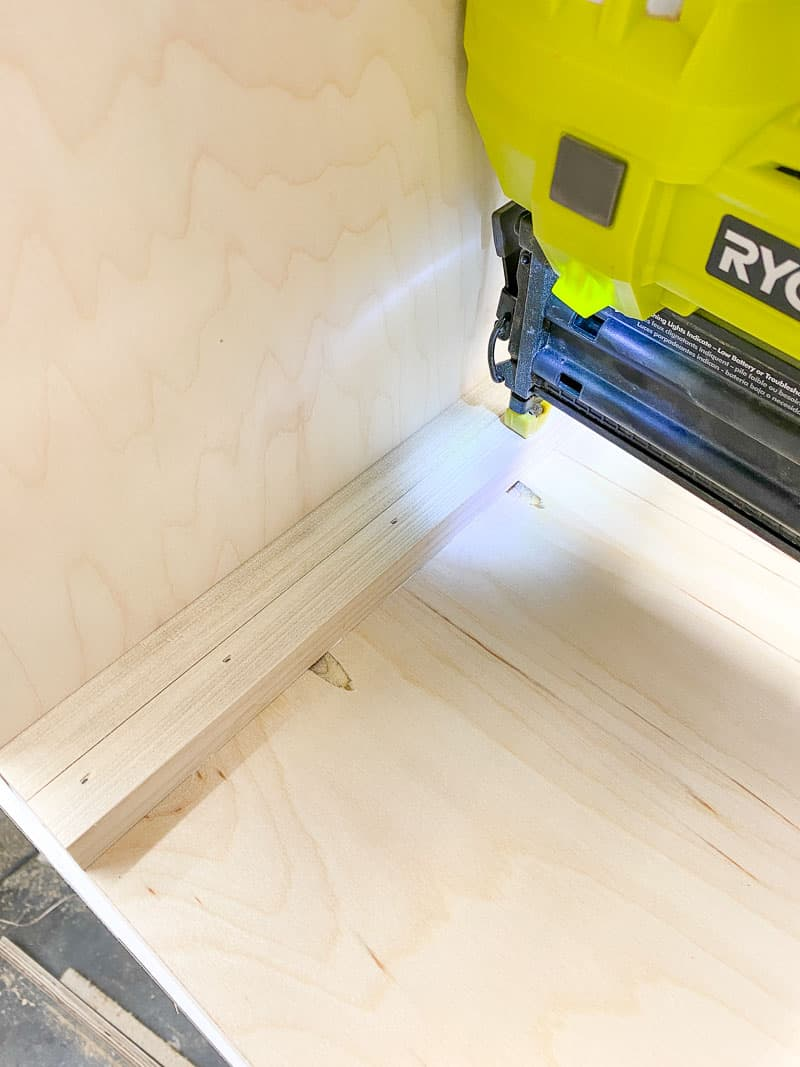 using a spacer to attach the drawer runners on the inside of the storage bin frame