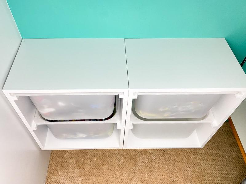 side by side DIY wall mount storage bins in closet