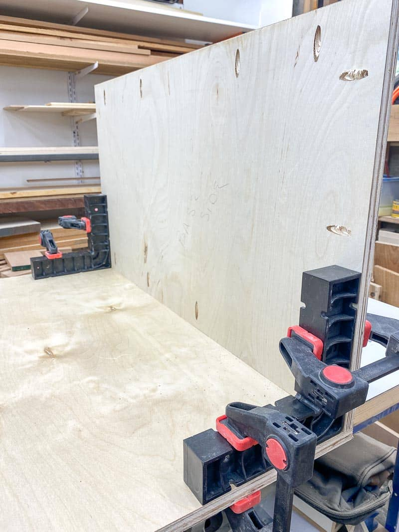 assembly squares holding table saw stand pieces upright