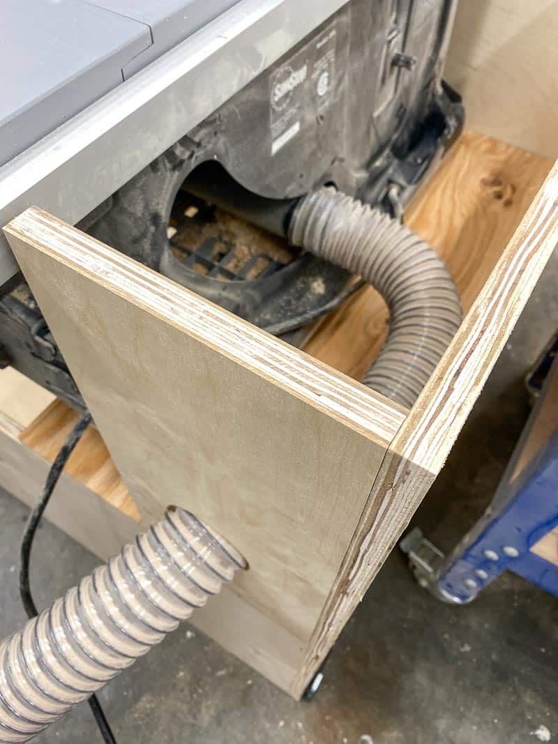 table saw stand with dust collection hose