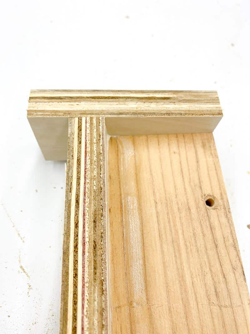 stop block at end of table saw dust tray bracket