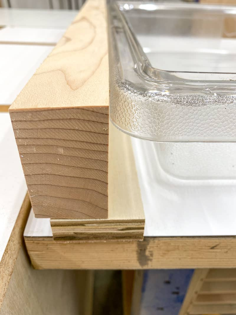 bracket for dust tray under table saw
