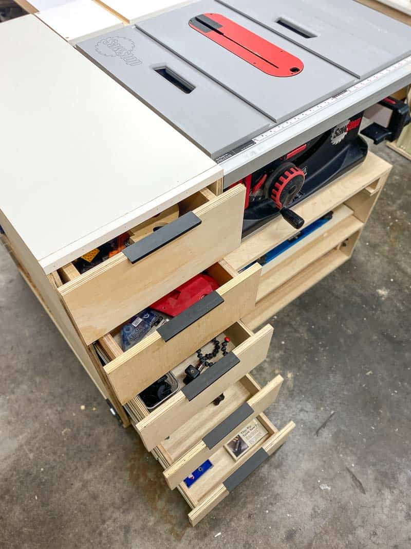 DIY table saw stand with drawers open