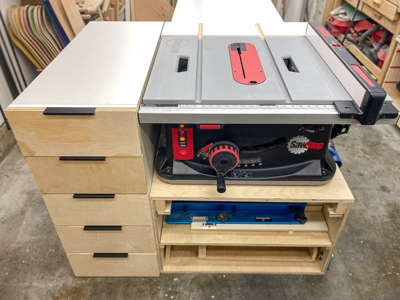 DIY table saw stand with outfeed, drawers and shelves