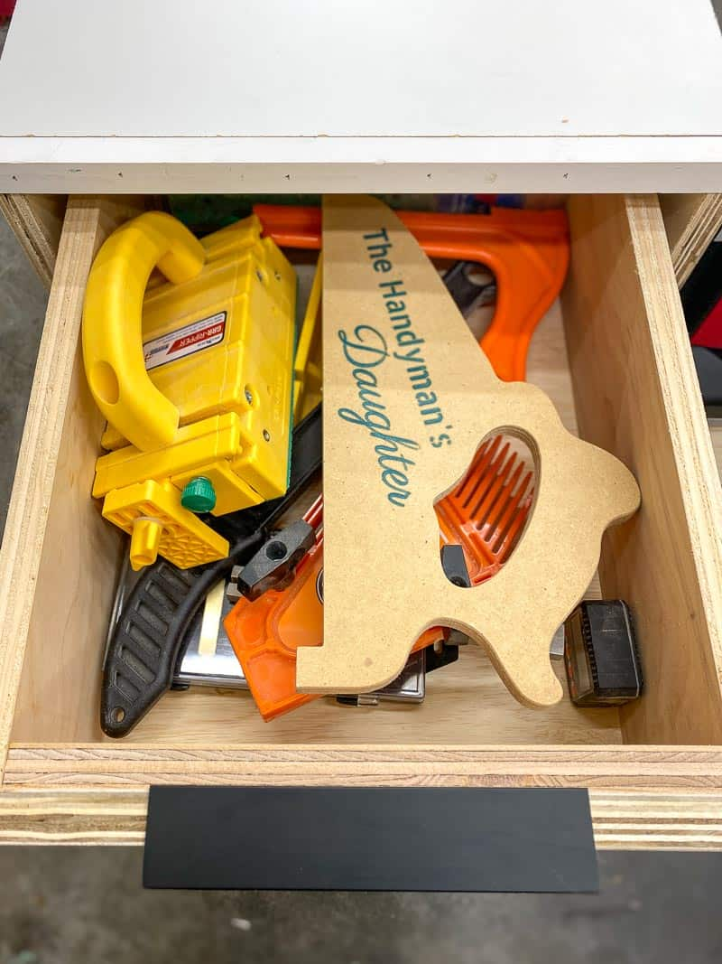 drawer open with table saw push sticks and blocks inside