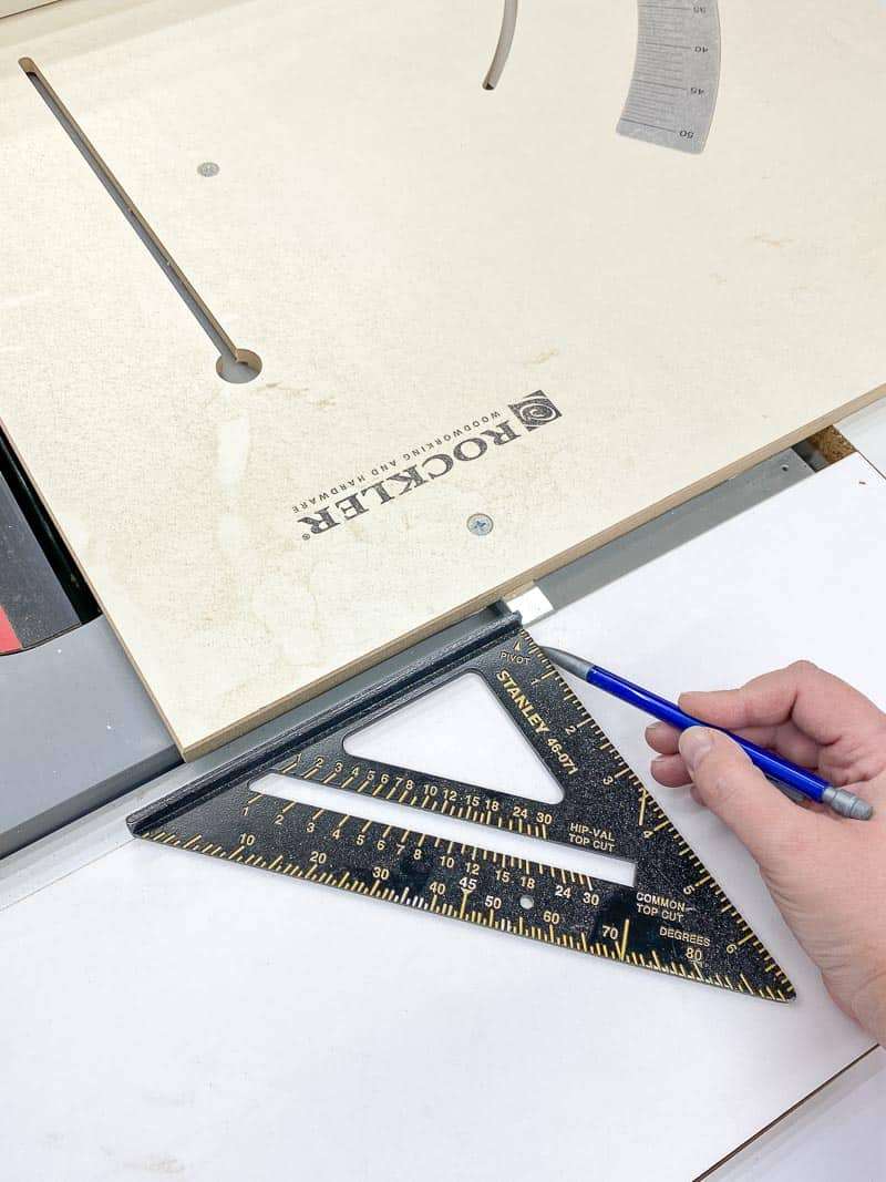 marking placement of grooves for outfeed section of table saw stand