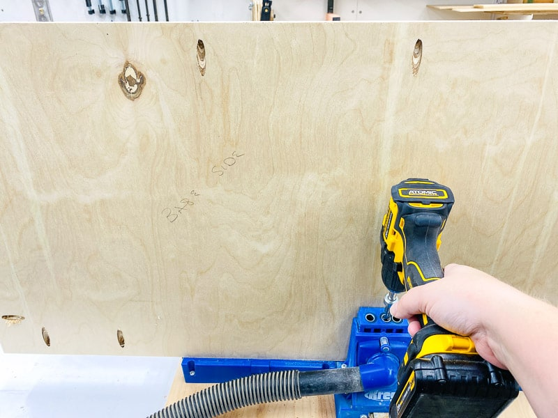drilling pocket holes in one board of the table saw table