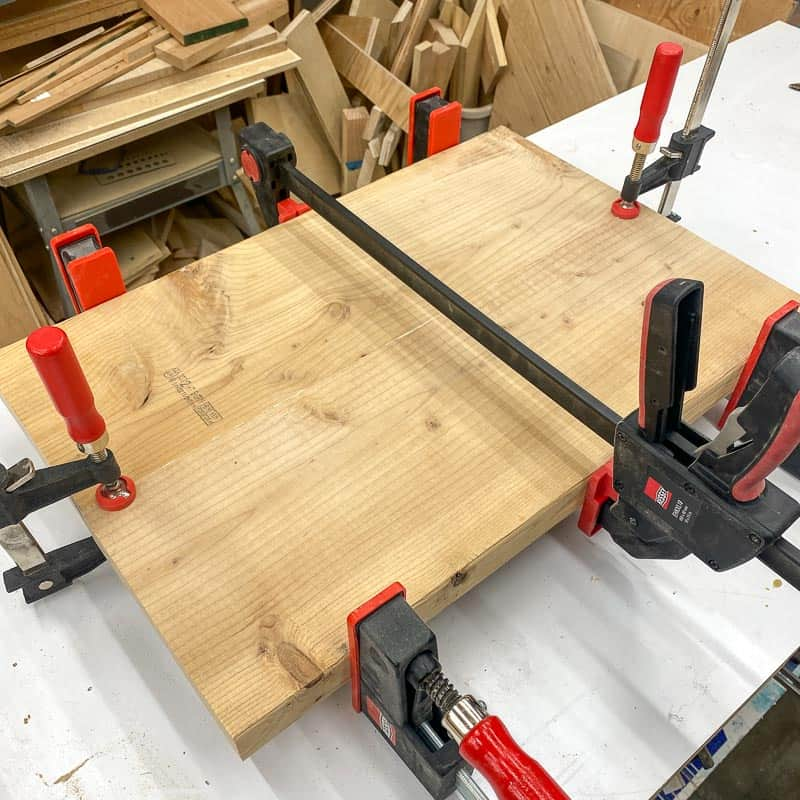 two boards joined together with wood glue and clamps
