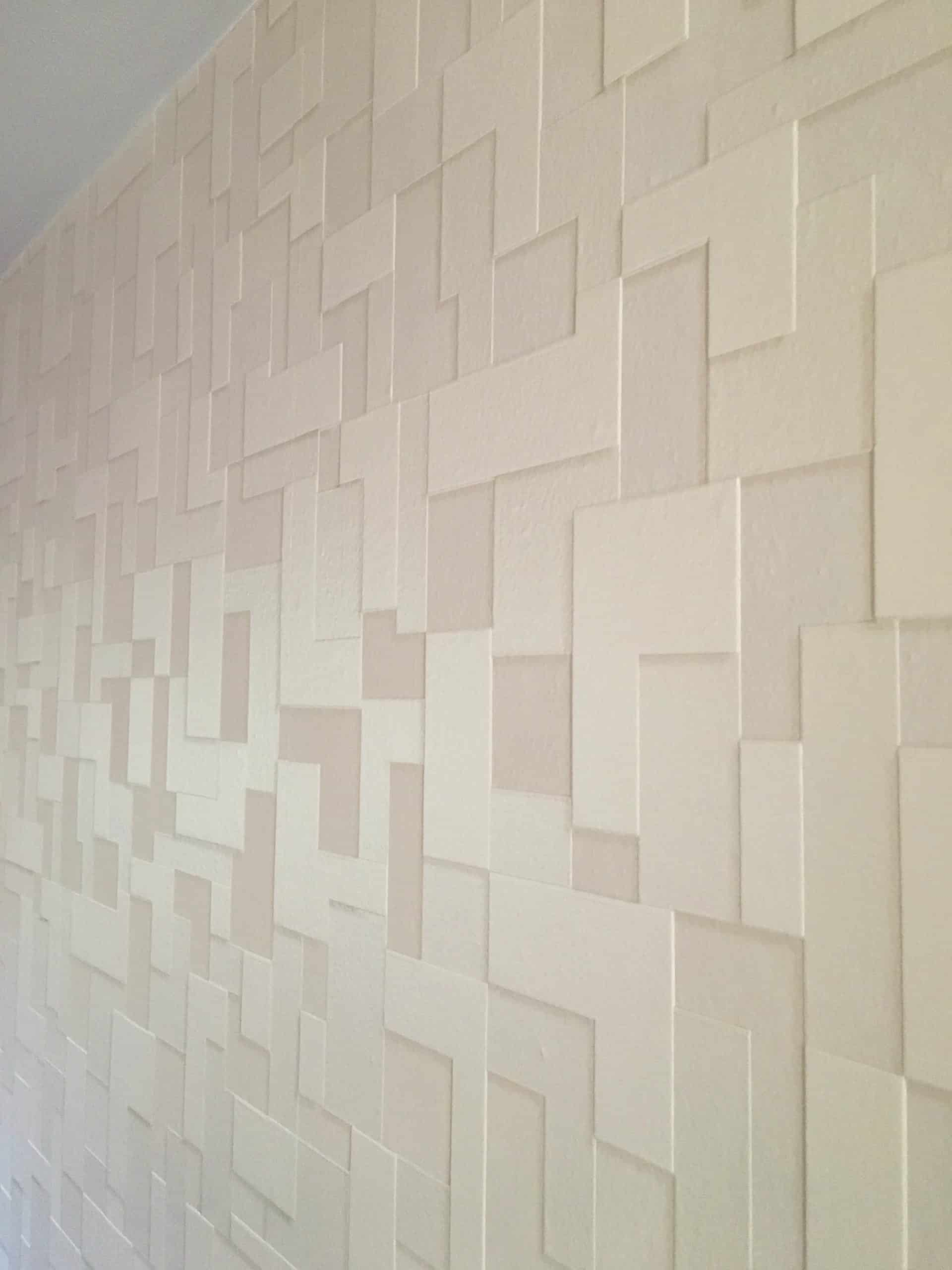 patterned wallpaper in varying shapes and shades of beige