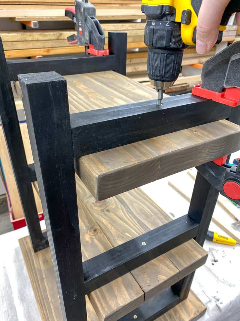 attaching the bottom shelf of the rustic end table