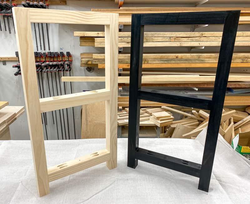 black frame next to natural frame on workbench