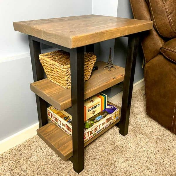 DIY rustic end table next to brown recliner