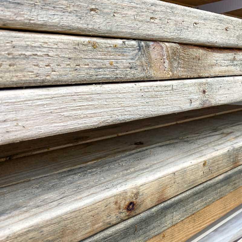 reclaimed 2x4 lumber on lumber rack
