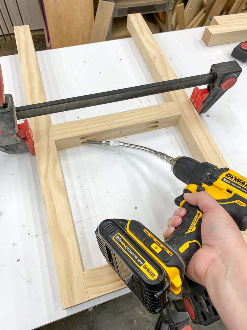 using a flexible right angle drill adapter to attach the rungs of the end table legs together with pocket hole screws