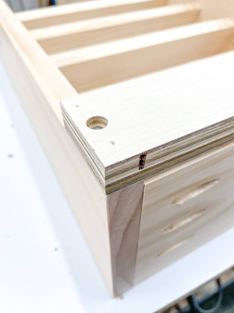 strip of wood at bottom of spray paint rack to hold french cleat vertical