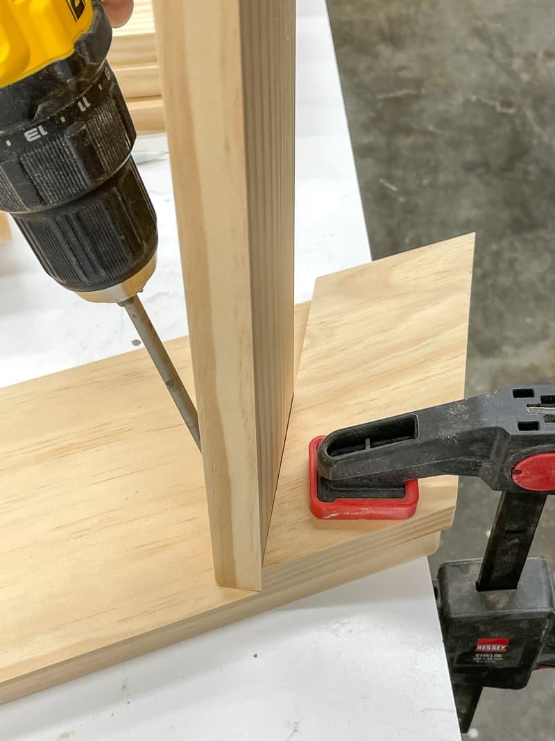attaching first shelf of spray paint storage rack with pocket hole screws