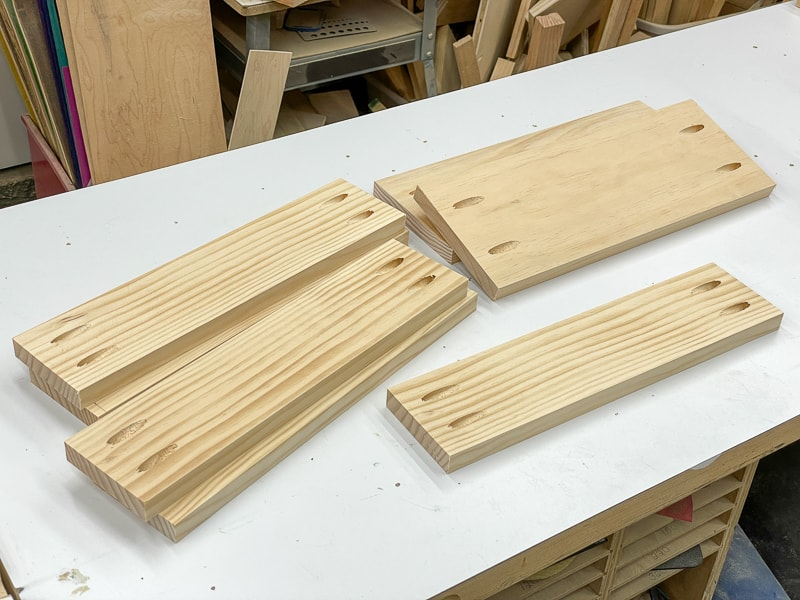 pocket holes drilled in both ends of all the shorter boards of the spray paint rack