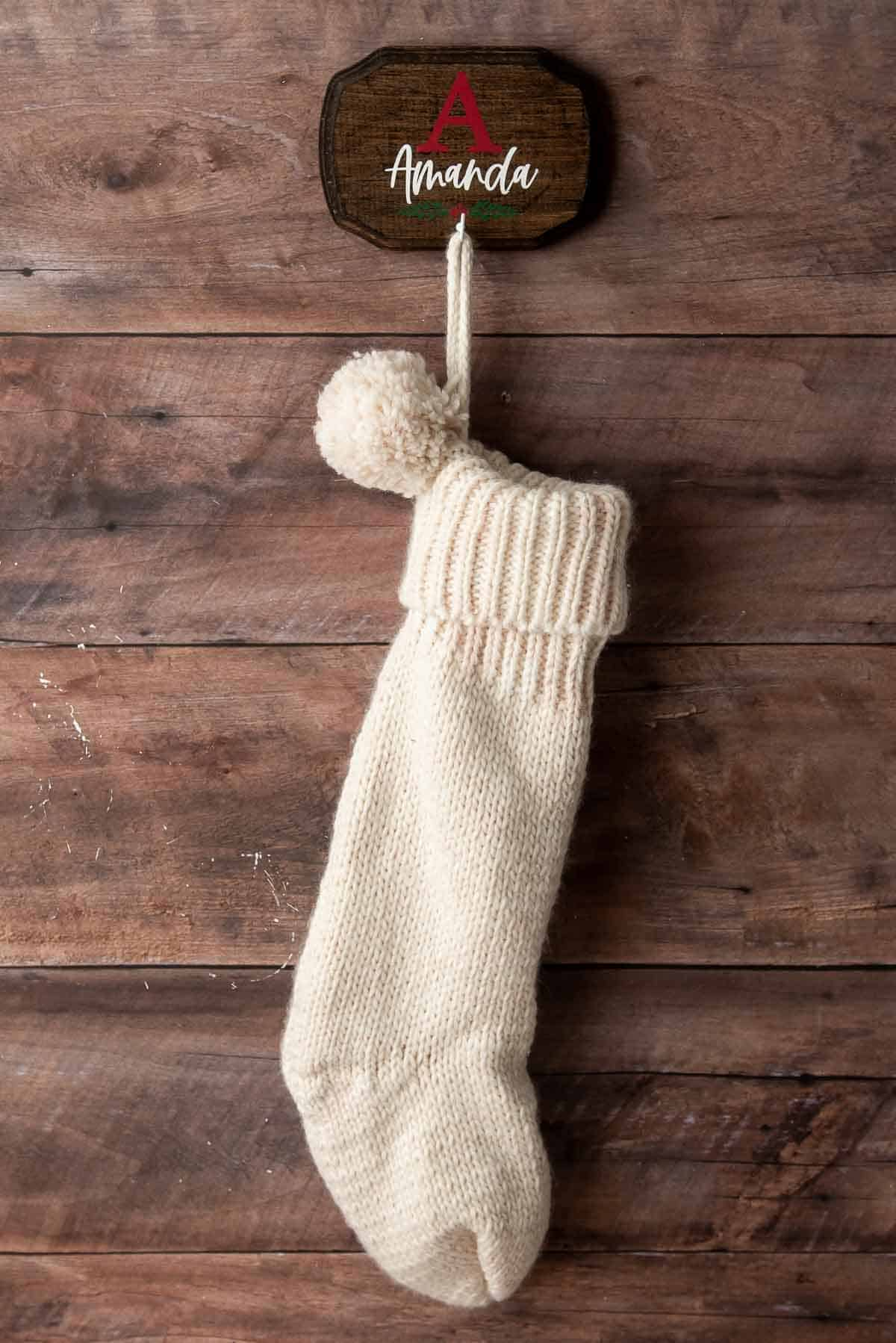 personalized DIY wall mount stocking hanger with knit stocking on wall