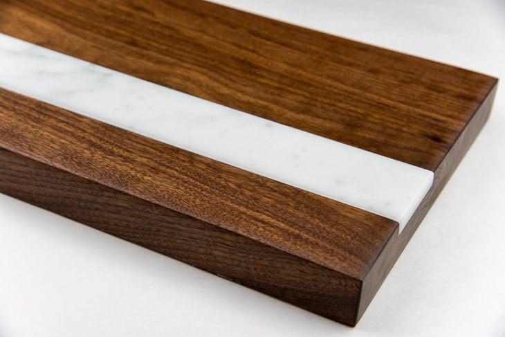 walnut cutting board with marble inlay