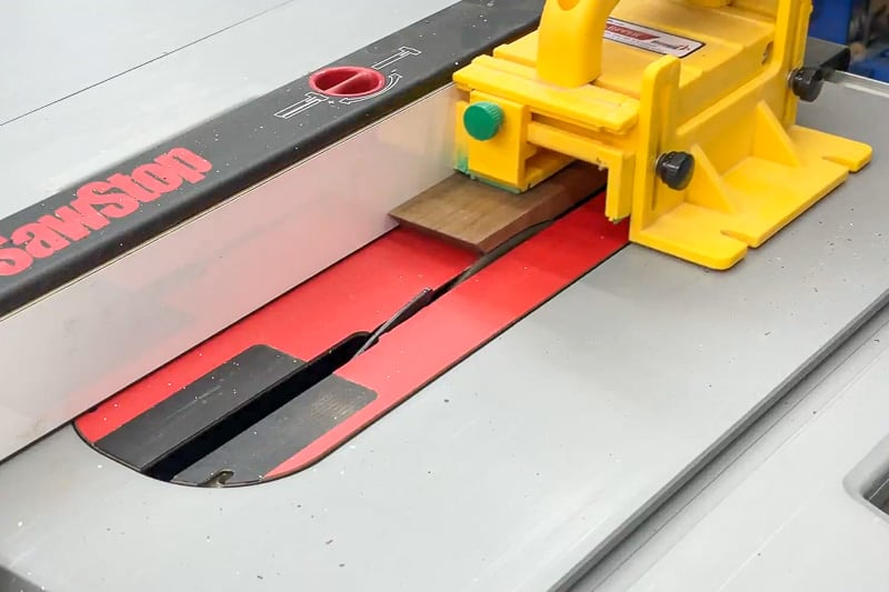 cutting rabbet along bottom inside edge of dice tray sides at the table saw