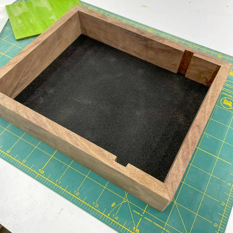 felt covered bottom in dice tray