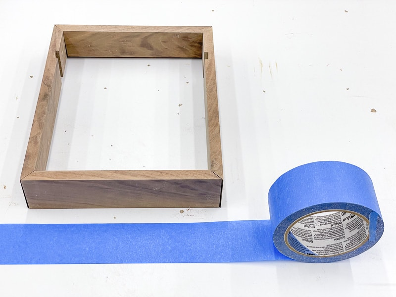 dice tray frame with roll of painter's tape
