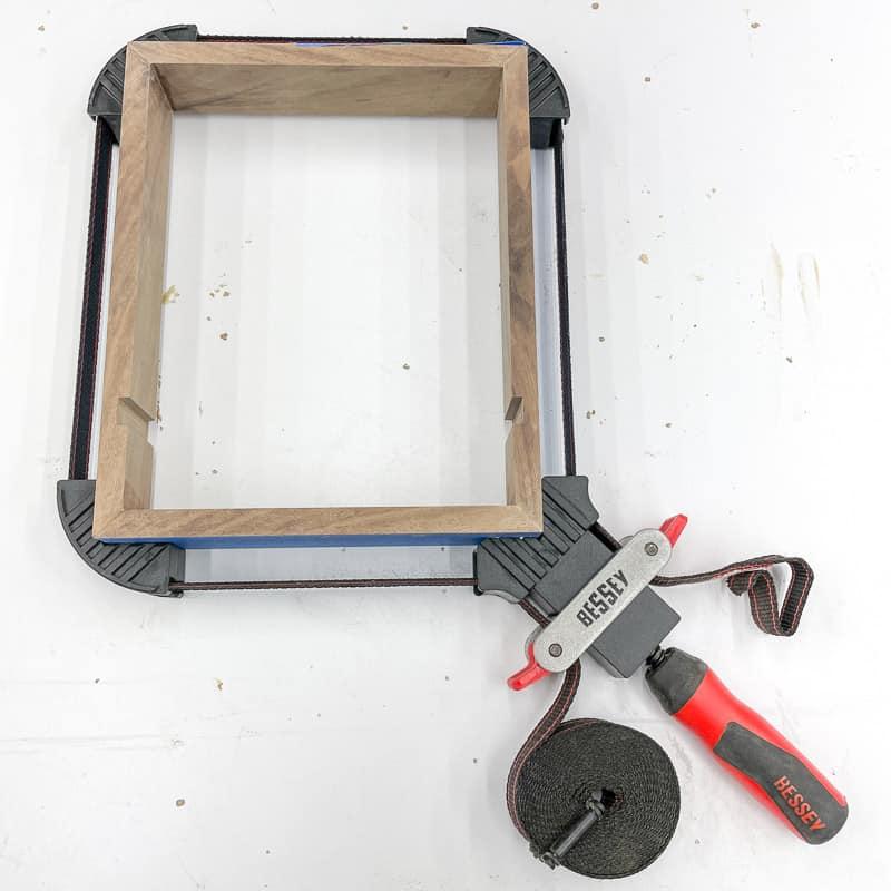 strap clamp around dice tray