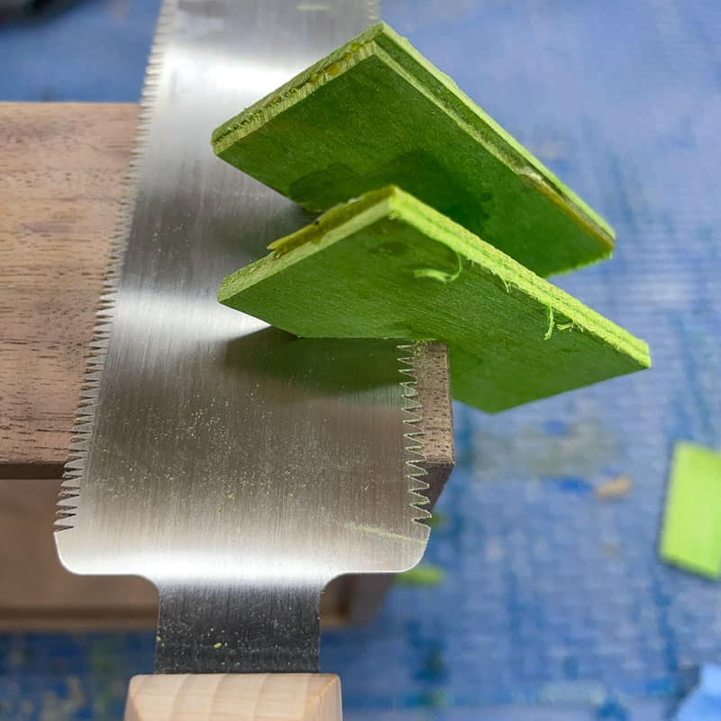 cutting excess splines from box with flush trim saw