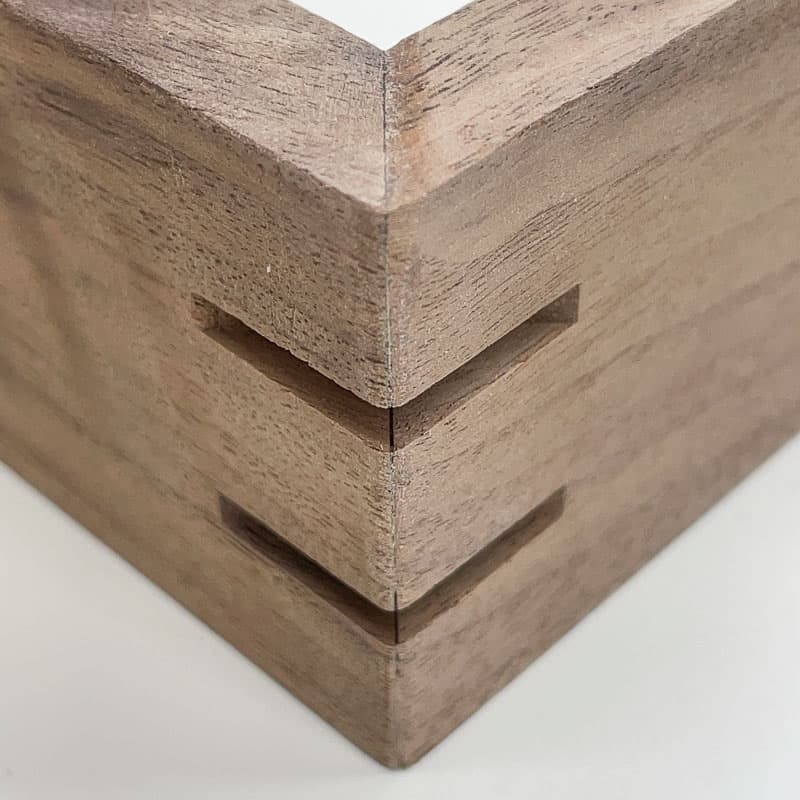 grooves cut in mitered corners for splines