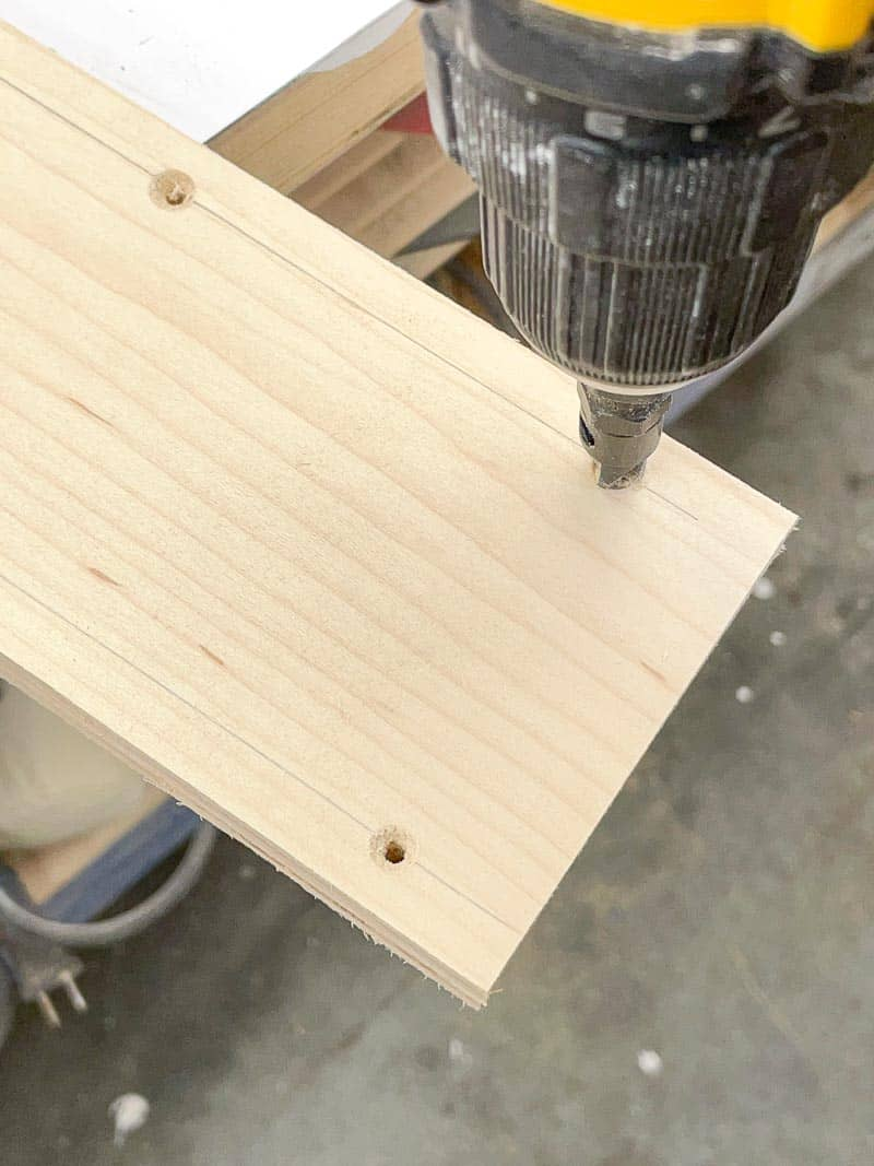 drilling countersink holes along the top of the spline jig saddle