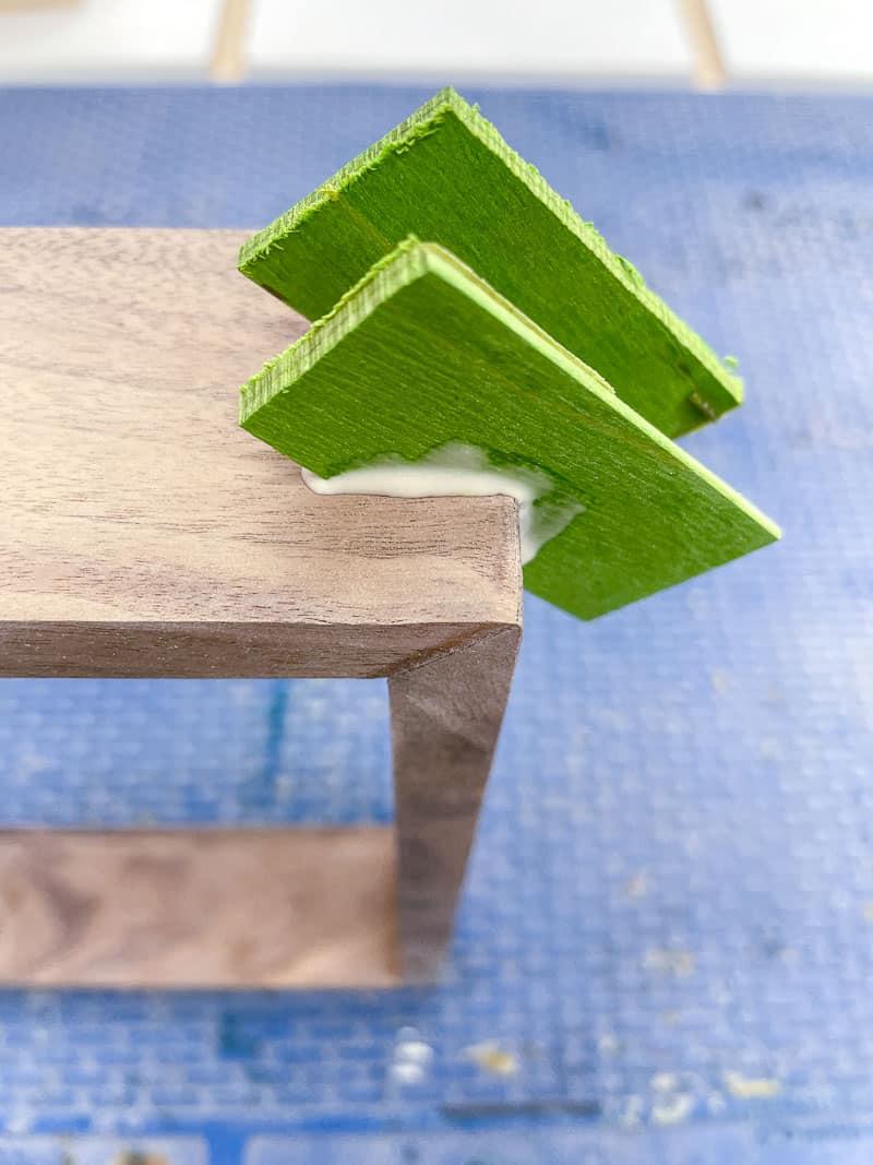 green wood veneer splines in grooves in walnut