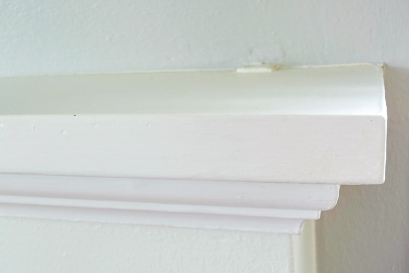 old fireplace mantel with exposed bracket