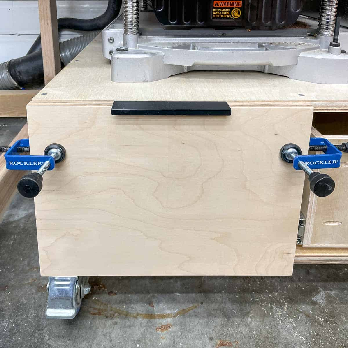 installing drawer front on drawer in planer stand with specialty clamps