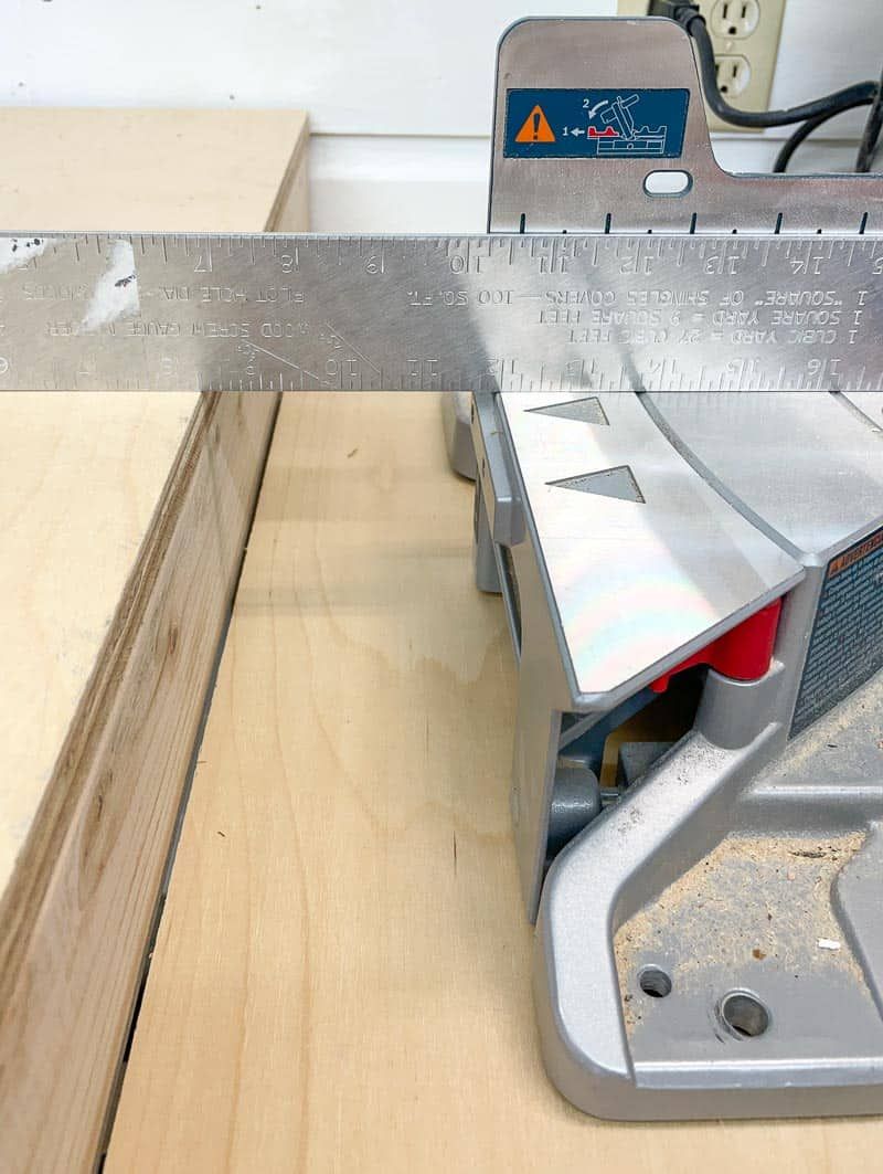 checking for level between miter saw and sides