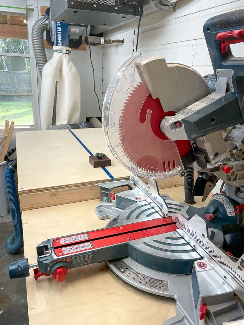 miter saw station with stop block and dust collector