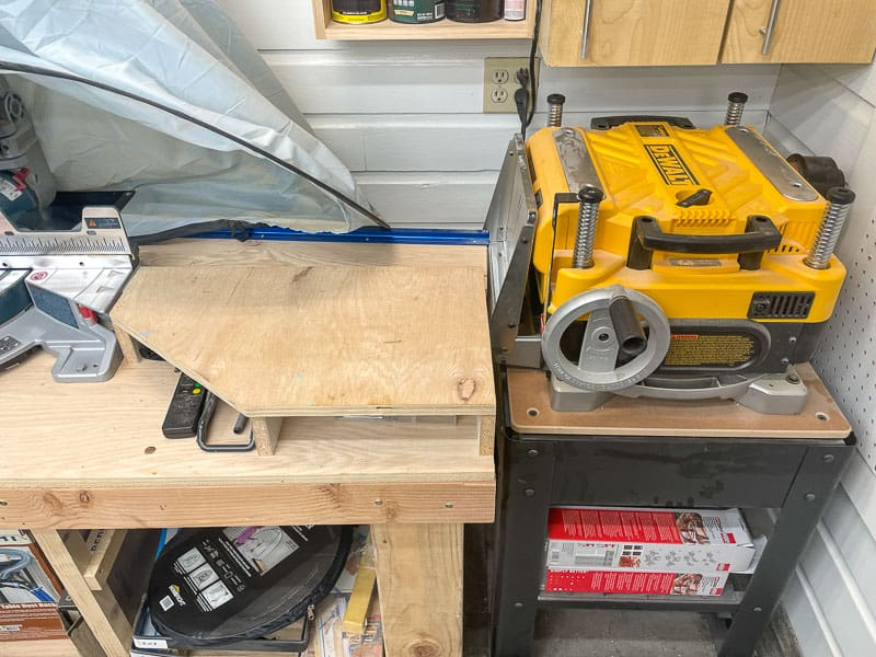 old miter saw station with platforms on sides and thickness planer blocking one end