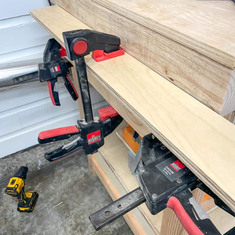 platform support for miter saw clamped to legs of miter saw station