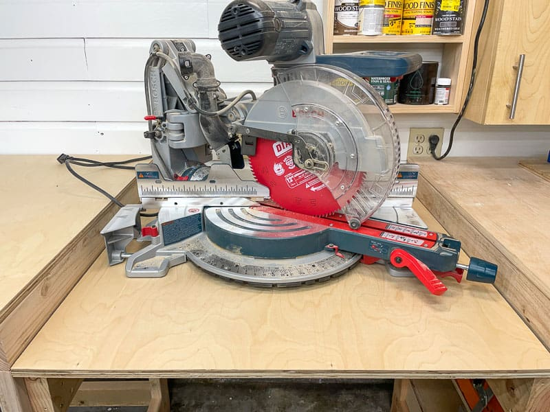 testing width of miter saw on platform of miter saw stand
