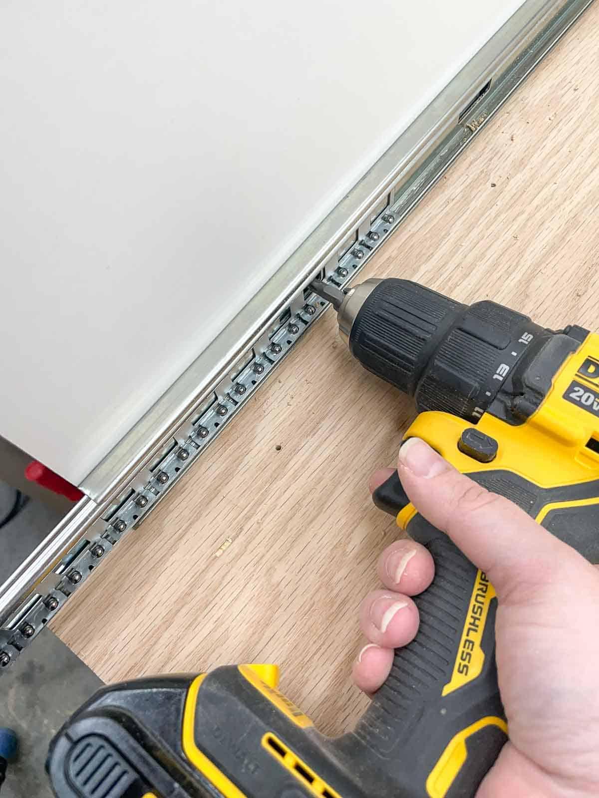 screwing drawer slides into planer stand sides